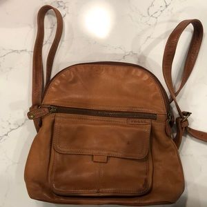 Leather backpack with top handle.
